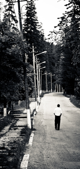 man walking down a street